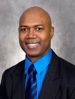 Dr. Joseph Armotrading